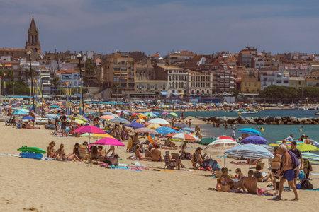Beach life in a small spanish town Palamos (Spain,Costa Brava), July 27, 2017, Spain