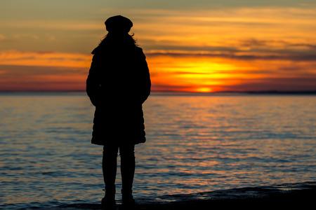 People silhouette on the sunset light near the lake Balaton in Hungary Standard-Bild
