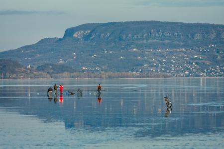 Ice fishing on the lake Balaton in Hungary