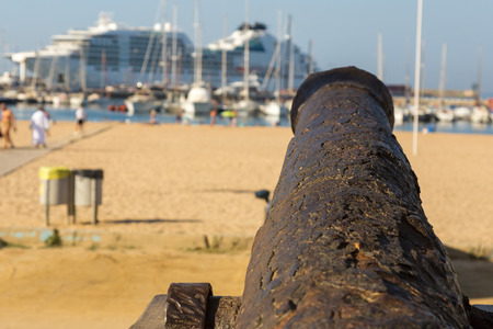 Old cannon on the promenade near the harbor in Palamos