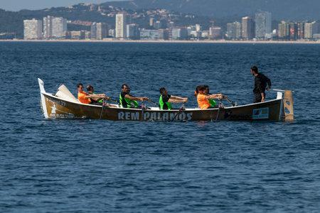 Rowing team on the ocean in Palamos, Costa Brava in Spain. 05. 20. 2018 Spain Editorial