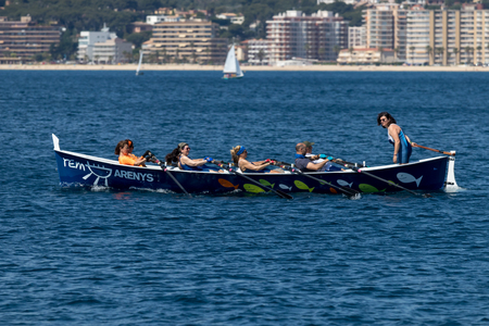 Rowing team on the ocean in Palamos, Costa Brava in Spain. 05. 20. 2018 Spain Editorial