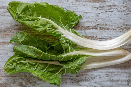 Healthy vegetable chard on a rustic wooden board