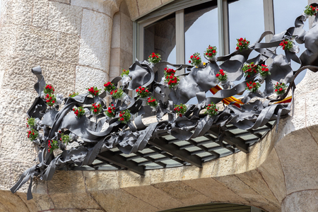 The Day of the Rose o The Day of the Book in Catalonia of Spain. The main event is the exchange of roses and books between sweethearts, men gave women roses, and women gave men a book to celebrate the occasion. Facade Casa Mila . 23. 04. 2017 Spain