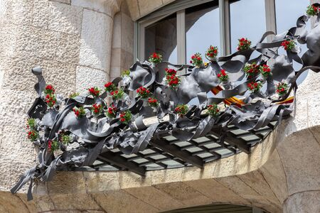 The Day of the Rose o The Day of the Book in Catalonia of Spain. Men gave women roses, and women gave men a book to celebrate the occasion. Facade Casa Mila . 23. 04. 2017 Spain