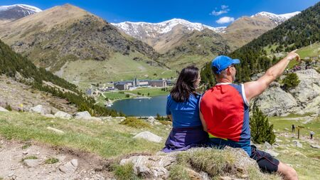 Two tourist in a nice valley from Spain, mountain Pyrenees (name Vall de Nuria) Imagens