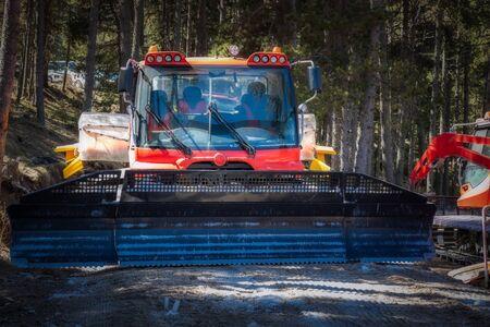 Snow goomer waiting near the ski slope in Spain