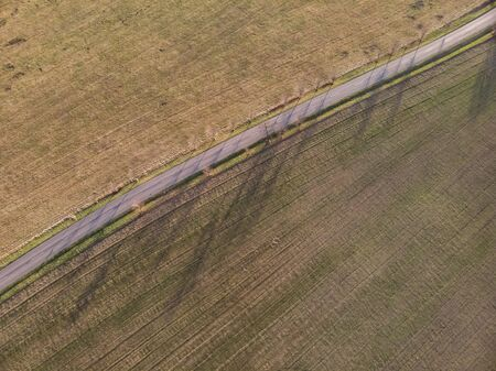 Aerial drone picture over asphalt road