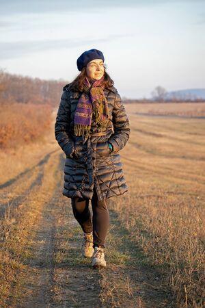 Pretty woman walking in the autumn oak forest