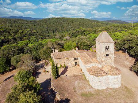 Old chapel in the forest in Spain. Santa Coloma de Fitor. Costa Brava in Catalonia