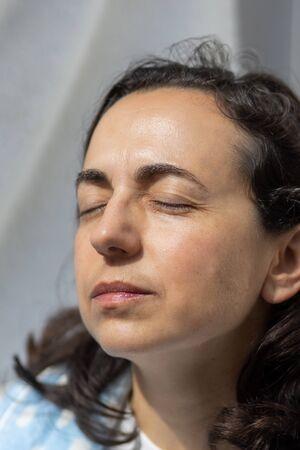 Pretty young hispanic woman sunbathing