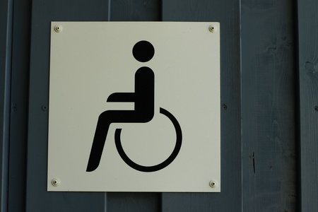 white sign of a wheelchair toilet Stock Photo - 17037040