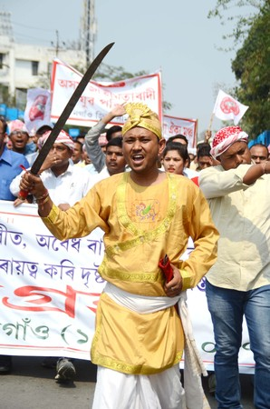 recently: A member of of AASU in traditional attire with a sword in hand march out  Satyagrharally in Nagaon district of Assam on Friday, protesting against the vandalising of AASU office in Silapthar by a Bengali organisation recently Editorial