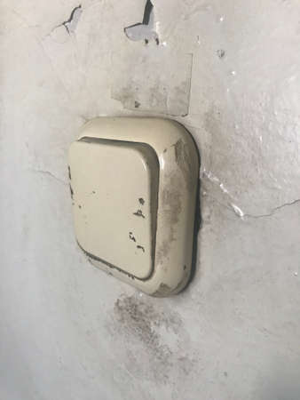 Old white switch light power technology electricity. Vintage wall control energy button equipment