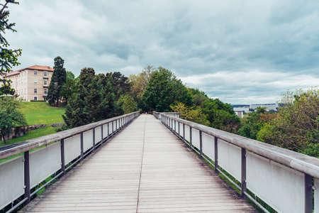 Wooden bridge over park Parc des Hauteurs in Lyon, France Stock Photo