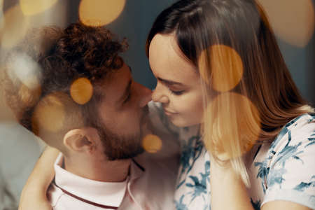 Closeup portrait of lovers. Bokeh effect of garlands. Soft focus image Reklamní fotografie