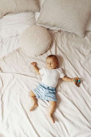 Adorable baby sleeping on white bed with copy space 스톡 콘텐츠
