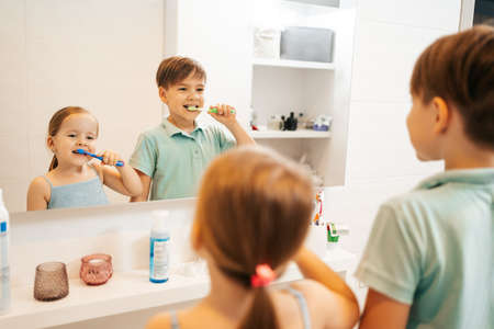 Hands of children At bath Washing hands with soap under the faucet with water. Clean and Hygiene concept. 스톡 콘텐츠 - 154756170