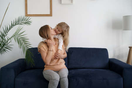 Togetherness Concept. Daughter hugging her mum. Love family, parenthood childhood concept. Mom and her kid playing together
