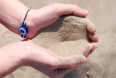 Sand running through hands Stock Photo