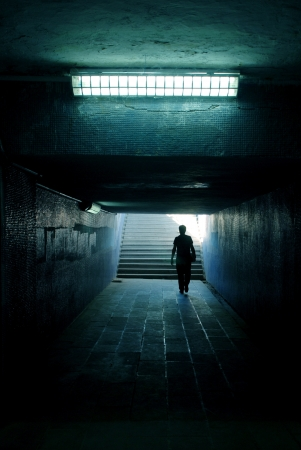 a man walking in the tunnel photo