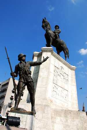 A monument of a soldier and Ataturk