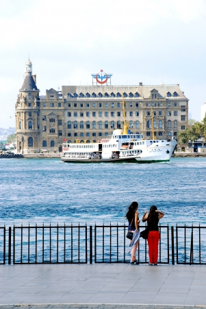 Two girls watching Haydarpasa Train Station in Istanbul, Turkey