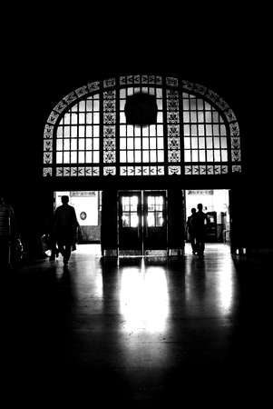 Black silhouette of the people leaving dark lobby Stock Photo - 16596874