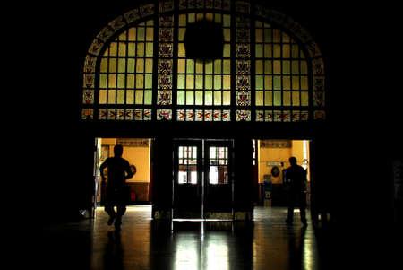 Black silhouette of the people leaving dark lobby photo