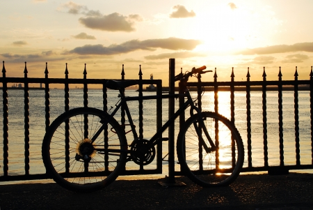 Bike silhouette in the sea at sunset