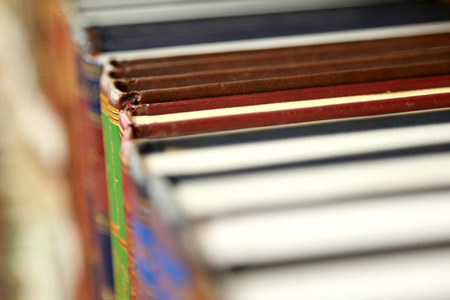 Colorful books in a row at library shelves
