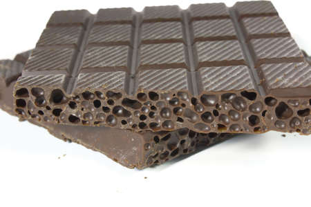 Porous chocolate, photo close up on a white background. photo