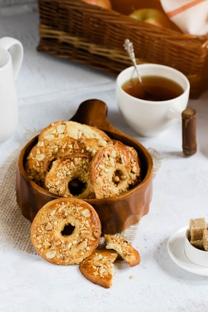Homemade peanut cookies in a wooden bowl. Tea time in a rustic style.