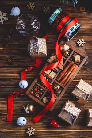 Seasonal and holidays concept. Christmas decorations and sweets on wooden board Stock Photo
