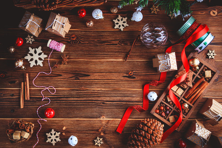 Seasonal and holidays concept. Christmas decorations and sweets on wooden board with place for copy space. Top view.