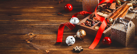 Seasonal and holidays concept. Christmas decorations and sweets on wooden board with place for copy space Stock Photo
