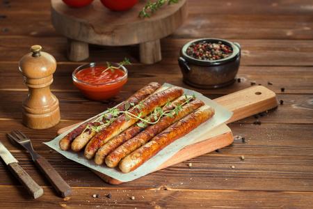 Pork chipolata. Close-up view of fried sausages.