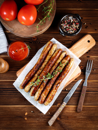 Pork chipolata. Close-up view of fried sausages. Meat dish Stock Photo