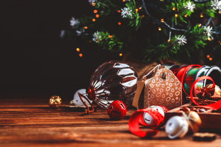 Seasonal and holidays concept. Christmas decorations and sweets on wooden board with place for copy space. Selective focus Stock Photo