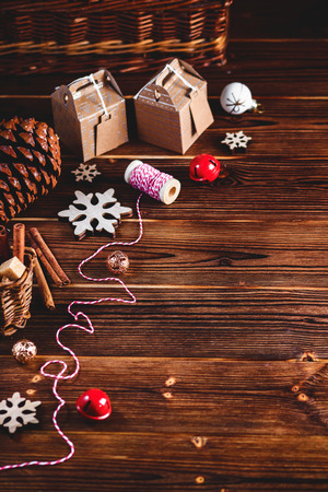 Seasonal and holidays concept. Christmas decorations and sweets on wooden board with place for copy space. Top view Stock Photo