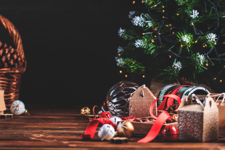 Seasonal and holidays concept. Christmas decorations and sweets on wooden board with place for copy space. Stock Photo