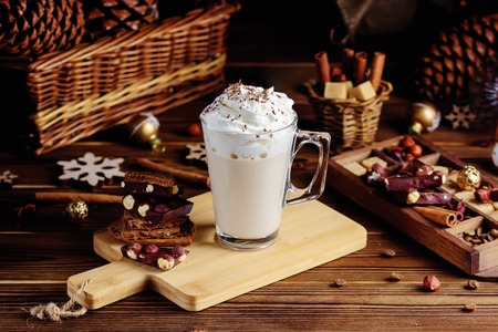 Hot chocolate drink with whipped cream. Cozy Christmas composition on a dark wooden background. Sweet treats for cold winter days Stock Photo