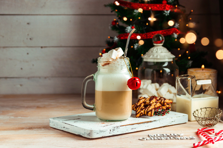 Mug with hot chocolate drink and marshmallows on the top. Christmas colorful still life. Cozy festive mood Stock Photo
