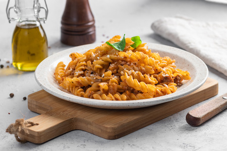 Pasta Bolognese. Fusilli with minced meat and grated cheese.