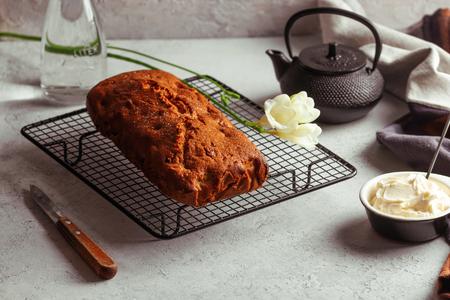 Fresh moist homemade delicious raspberry cake on black cooling rack.