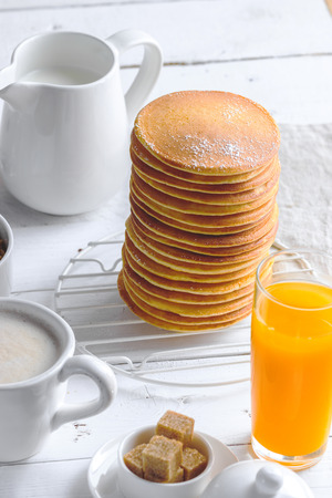 Close up of tall pancakes stack. Concept of tasty breakfast Stock Photo