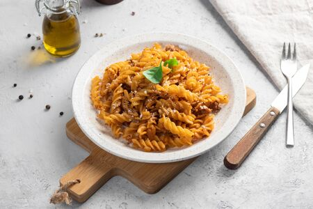 Pasta Bolognese. Fusilli with minced meat and grated cheese Stock Photo - 135583485