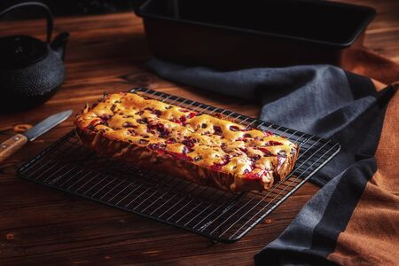 Fresh moist homemade delicious raspberry cake on black cooling rack Stock Photo - 135583488