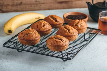 Homemade fresh banana and chocolate muffins on cooling rack