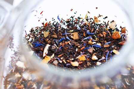 Close up of winter mix black tea tropical fruit cornflowers and spices in a teapot, Stock Photo - 135583518